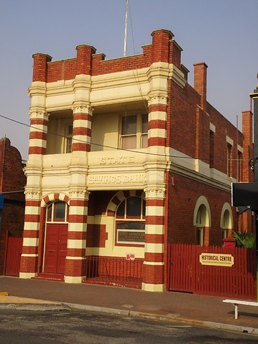 Warracknabeal. The State Savings Bank built with polychromatic brick work as a single story bank in 1909. Upper floor with different style of windows added in 1921.