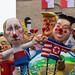 Politicians, presidents and dictators like Kim Jong-un, Trump,  Xi Jin Ping, Boris Johnson and Wladimir Putin set the world on fire on satiric carnivals wagon