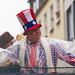Man wearing a USA-inspired stars & stripes costume on board the satirical wagon focusing on political themes at the Rose Monday parade 2020 in Cologne