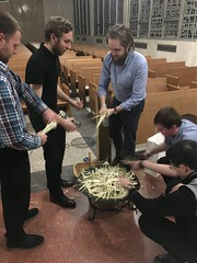 Seminarians prepare Blessed Palms from 2019 for burning, on Shrove Tuesday 2020.