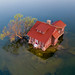 Tiny Island With Red Cottage