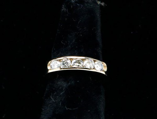 14k white gold Channel ring with 5 full cut diamonds ($616.00)