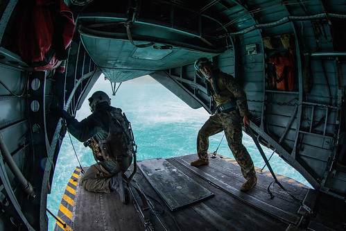 U.S. Marines look out of the back of a CH-53 Super Stallion helicopter during helocast training at Cobra Gold 2020