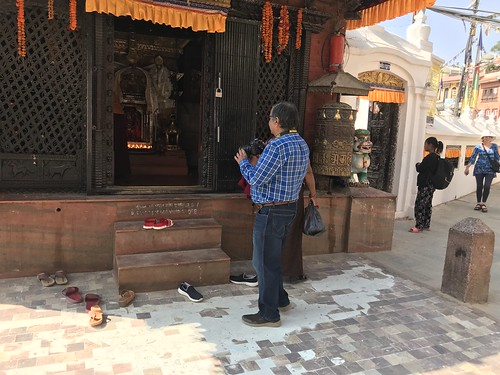 Trying to get a shot, sadly there were people obscuring the deity inside