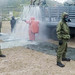 CBRN defense specialists scrub and screen for threats during a rehearsal with Royal Thai sailors and marines