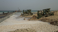 Sailors and Soldiers install a floating causeway during exercise Native Fury 20 in the UAE.