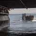 Landing Craft, Utility 1680 enters the well deck of the amphibious assault ship USS Boxer