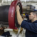 USS Dwight D. Eisenhower (CVN 69) conducts maintenance on an aircraft engine.