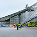 A man taking a selfie in front of Munich Olympiastadion (Olympic Stadium)