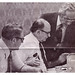 Union head and attorneys confer during arbitration: 1976