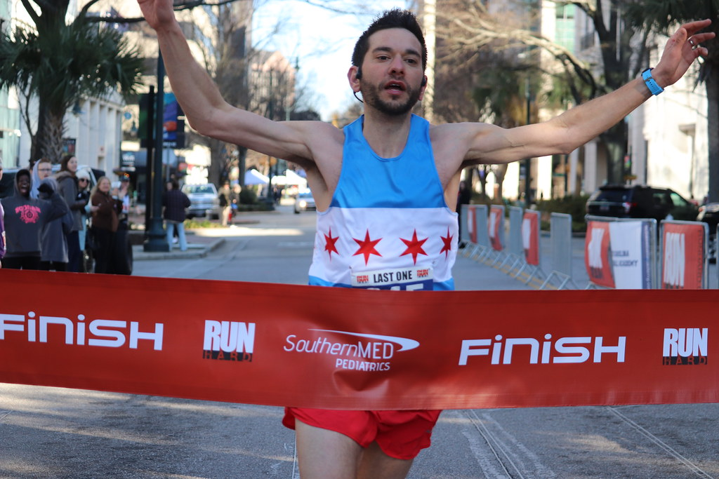 Crossing the finish line in first place at the Run Hard Columbia Half Marathon