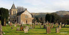 Photo of St Cuthberts Church,Main Street, Straiton  with the Straiton monument atop Craigengower Hill in the background,South Ayrshire.Scotland