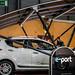 Electric car under an e-port solar energy station