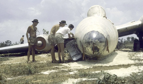 1964 RNZAF Canberra NZ6110 covered in foam after the pilot, Noel McGuire, retracted the undercarriage to bring the aircraft to a stop after a loss of power on takeoff during 'Operation Air Boon Choo' at Korat Airport, Thailand, 22 Apr 1964.