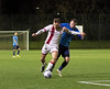 Chris Black tussles to get in behind the Talbot defence