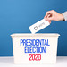 Man putting his vote in the ballot box for Presidental Election 2020