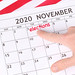 Man pointing date 3rd November 2020 marked in calendar