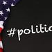 American flag with the text #politics against a blackboard background