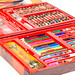 Set of colored pencils, felt-tip pens and paints in a red box