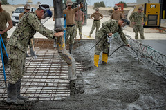 Seabees place 35 cubic yards of concrete for a pre-engineered building in Bahrain.