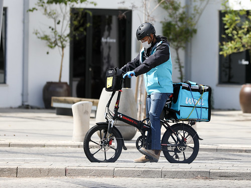 A masked delivery driver. Public Domain photo by Mussi Katz