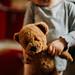 Little girl holding a teddy bear.