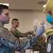 An Airman administers an N95 mask fit test