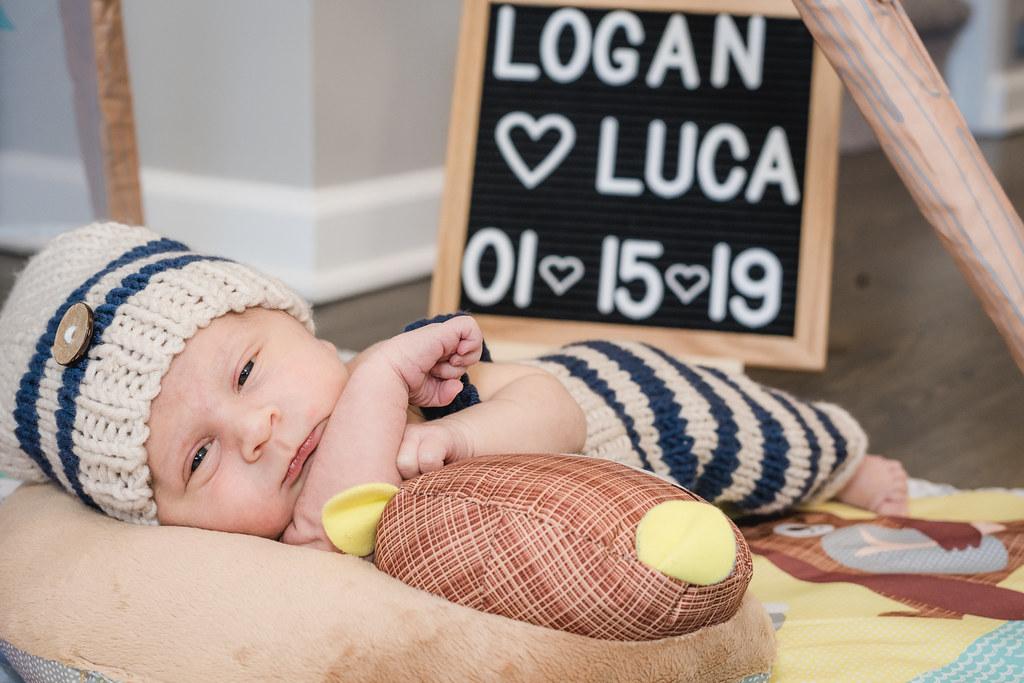 Newborn Logan checking out the world.