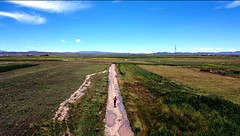 Taking a short cut through the fertile hinterland around Lake Titicaca's northern shores