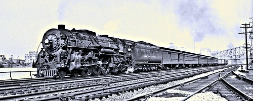 New York Central Railroad Locomotive 5264 pulling a train west of Point Bridge.  South Side Pittsburgh 7-18-1951