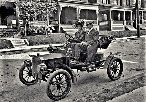 Charles Yon and his wife driving in a car in a neighborhood in Pittsburgh, Pa. 10-10-1907