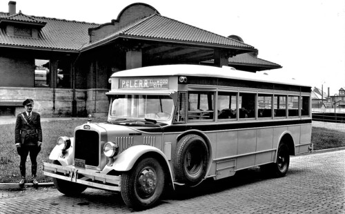 Pittsburgh and Lake Erie Railroad's Ellwood City [PA] Passenger Station bus{White] 1933