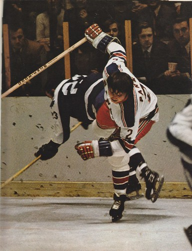 Bill MacMillan of the Maple Leafs and Brad Park of the NY Rangers, collide.