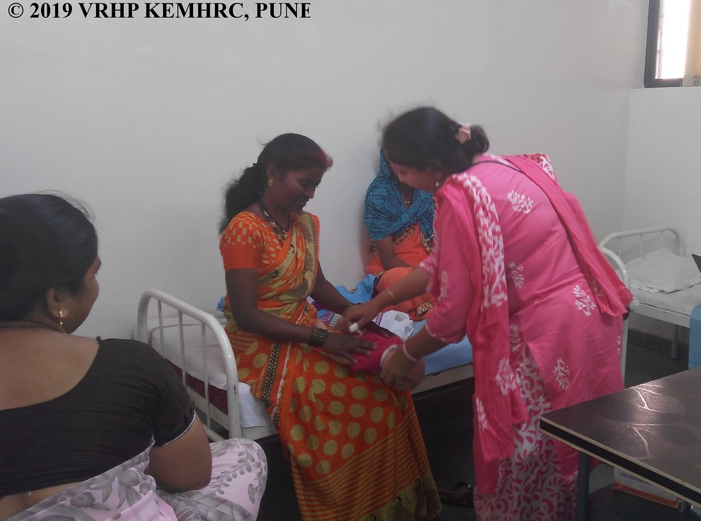 Demonstration of gentle oil massage at study clinic