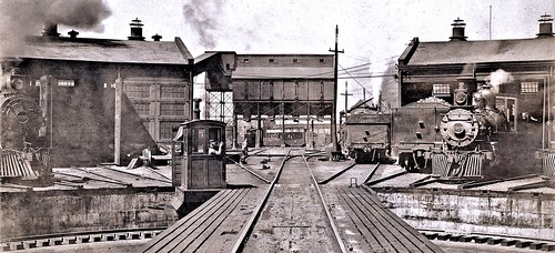 The coaling machine is the focus point of the picture, but several other buildings can be seen, as well as several locomotives. 8-1906
