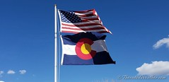 March 28, 2020 - Old Glory and the Colorado flag. (ThorntonWeather.com)
