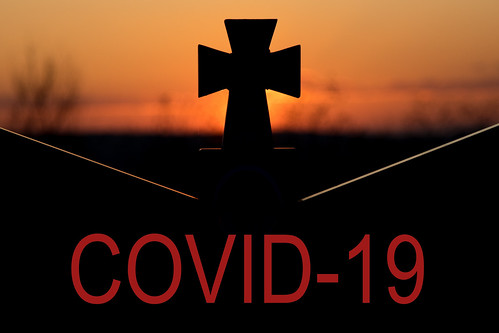 Cross on a gravestone and COVID-19 text, From FlickrPhotos
