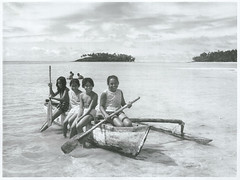Young children playing in an outrigger canoe, Rarotonga, 1969