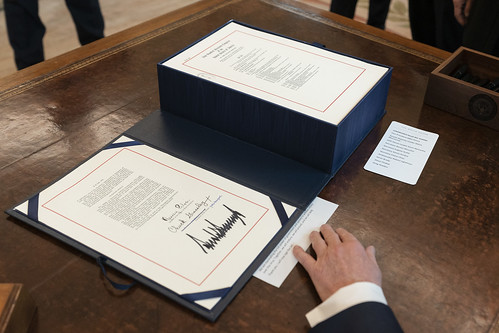 President Trump Signs the CARES Act by The White House, on Flickr