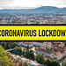 Coronavirus lockdown: City in Europe bordered by a yellow and black safety tape with the word coronavirus lockdown following the restrictive measures to prevent contagion spread