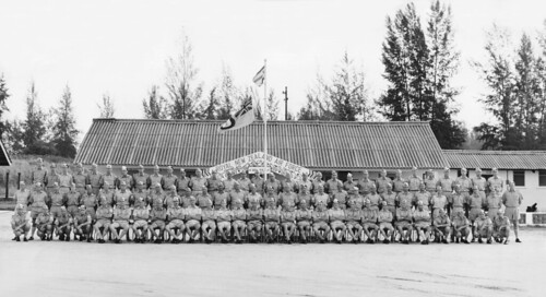 1965 RNZAF 41 Sqn staff (hats on) at Changi. The 10th anniversary of being in Singapore. Taken in front of the Maori Gate of welcome outside Sqn HQ, 5 Jun 1965 (scroll down for names, click twice to fully enlarge).