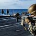 A Marine fires his M4A1 service rifle