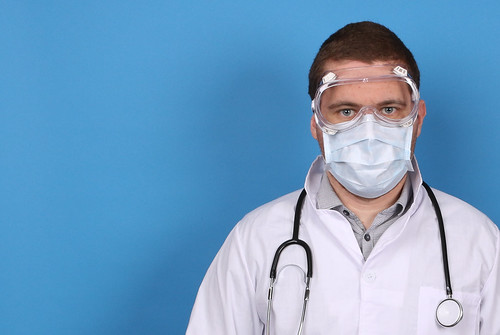 Doctor with face mask and stethoscope an by focusonmore.com, on Flickr