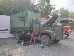 Overland trucks at a hostel, Osh.