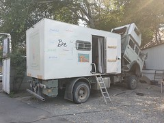 Overland trucks beeing fixed before leaving for the Pamirs.