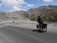 A bicyclist heading downwards for a change into Kyrgustan