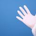 Medical glove on blue background