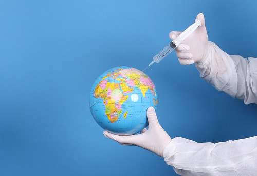 Pandemic concept, close up of scientist injecitng vaccine into the earth, From FlickrPhotos