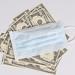 Medical face mask and money, world coronavirus epidemic and economic damages. Corona virus concept.