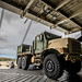 A U.S. Marine Corps Medium Tactical Vehicle Replacement is loaded onto the cargo ship USNS Dahl